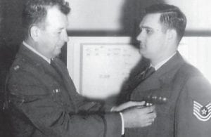 Col. Harold Evensizer (left) presents the Air Force Commendation Medal with 1st Oak Leaf Cluster for meritorious service to Everett Vanover.
