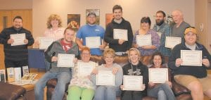 Pictured standing are (from left) graduates James Elliott of Hazard and Candala Nantz Gibson, Chris Hatton, Eagle Brosi, Kae Fisher, Josh May, and Roger Blair, all of Whitesburg. Seated from left are Ty Brock, Sarah Blair, Hettie Adams, Sarah Hatton, Crystal Mart, and William Banks, also all of Whitesburg.
