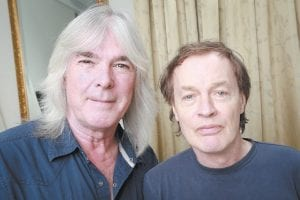 """Members of the rock band AC/DC, bassist Cliff Williams, left, and guitarist Angus Young posed for a portrait in promotion of their new album, """"Rock or Bust"""" in New York. The new album was released earlier this week. (Photo by Amy Sussman/Invision/AP)"""