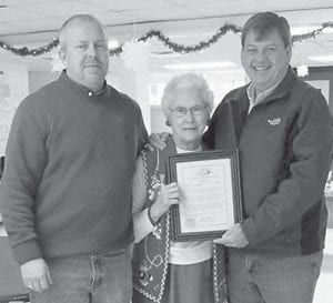 The family of Mable Johnson and the Fleming-Neon Senior Citizens Center program celebrated Mrs. Johnson's 79th birthday on Dec. 19 at Hemphill Community Center. Letcher County Judge/Executive Jim Ward (right) and Deputy Judge Eddie Meade (left) were on hand also. Ward officially declared Dec. 19 to be Mable Johnson Day, and awarded her with a commemorative certificate for her work with children and her community service.