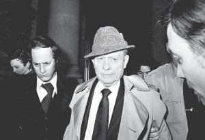 """Former UMWA President W. A. """"Tony"""" Boyle, center, looked toward his attorney Charles Peruto, right, as they left Delaware County Courthouse in Media, Pa., on Feb. 18, 1978, during Boyle's retrial on triple murder charges in the Dec. 31, 1969 deaths of Joseph """"Jock"""" Yablonski and his wife and daughter. Boyle was convicted again. (AP Photo)"""