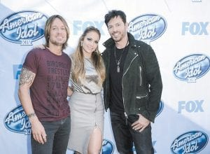 Pictured from left, singer Keith Urban, singer and actress Jennifer Lopez, and singer Harry Connick, Jr. arrive on set of American Idol XIV in Los Angeles. The singing contest returns for its 14th season premiering tonight (Wednesday) with judges Connick Jr., Lopez and Urban, and music producer Scott Borchetta as a new mentor. (Invision/AP)