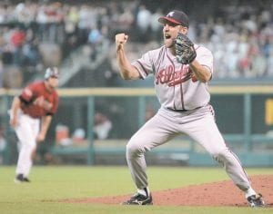 Atlanta Braves pitcher John Smoltz reacted as Houston Astro Lance Berkman, background, walked off the field after the final out of their National League Division Series Game 4. Smoltz was elected to the National Baseball Hall of Fame Tuesday. (AP Photo)