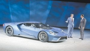 FORD SHOWS NEW CAR — Ford Motor Co. Executive Chairman Bill Ford, left, and President and COO Mark Fields stood next to the new Ford GT during the North American International Auto Shown this week in Detroit. (AP Photo)