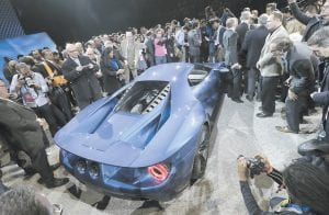A HIT WITH THE PRESS — Journalists surround the new Ford GT after it was unveiled this week at the North American International Auto Show in Detroit. (AP Photo)