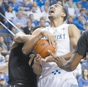 Kentucky's Trey Lyles, right, gets ties up with Vanderbilt's Jeff Roberson during Tuesday's win. (AP)