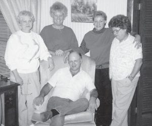 The Bill and Mary Napier family, formerly from Marlowe, are (left to right) Laura Napier (Holland); Margaret Hatton (Combs); Alicia Napier (Staley), Virgil's daughter; Norma Napier, Burchel's wife; and (seated) Ernie Napier, son of Norma and Burchel.
