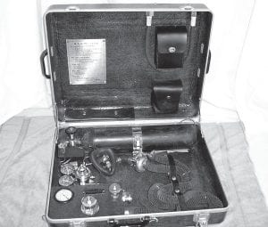This photo from the National EMS Museum shows the Pneolator, introduced in December 1950 by the Mine Safety Applicances Company in Pittsburgh and purchased for use in emergencies by the Jenkins Kiwanis Club in the winter of 1955. The artificial respirator had pressure settings for infant, child and adult. It also had a oxygen powered aspirator to remove secretions from the patient's airway. The Pneolator weighed 46 lbs. (Photo courtesy National EMS Museum)