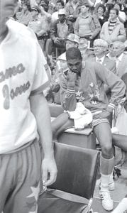 "Above, Houston's Akeem Abdul Olajuwon sat stunned after a last second shot by North Carolina State in the 1983 NCAA final ruined the perfect season for ""Phi Slama Jama."" At left, Tommy Kron passed to Larry Conley in No. 1 Kentucky's shocking loss in 1966. (AP)"