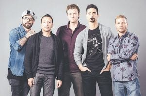 "From left, AJ McLean, Howie Dorough, Nick Carter, Kevin Richardson, and Brian Littrell of the Backstreet Boys pose for a portrait in promotion of their theatrical documentary ""Show 'Em What You're Made Of."" One of the biggest-selling boy bands in history, the Backstreet Boys have experienced highs and lows. They say making a comeback 20 years later and introducing themselves to new fans as grown men in a ""boy band"" is scary. (Invision/AP)"