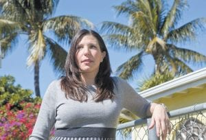 Marisa Hargrove stands in her backyard in Bay Harbor Islands, Fla. Hargrove, 42, was working in her backyard in 2014 when she believes she was bitten by a mosquito carrying the chikungunya virus, becoming one of the first Americans to have caught chikungunya from local mosquitoes. (AP Photo)