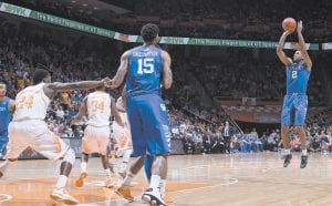 Kentucky's Aaron Harrison (2) shoots against Tennessee in the first half of Tuesday night's game in Knoxville. (AP Photo)