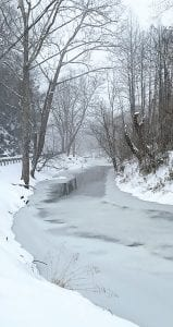 Ice was forming in the North Fork of the Kentucky River at Mayking when this photo was taken Tuesday night. The river will be frozen solid at this location if colder temperatures arrive in the area as expected as the week continues.