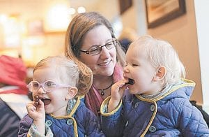 Michelle Moore poses for a photo with her twin daughters, Sierra, right, and Savannah in Lake Oswego, Ore. Moore is not opposed to medicine, thinks vaccines have a place and are a medical choice that should be researched carefully. Moore is among the vaccine skeptics who have been widely ridiculed recently. (AP Photo)