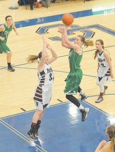 Whitney Creech, the nation's leading scorer, goes up for two of the 40 points she scored in her team's loss in the district tournament. (Photo by Chris Anderson)