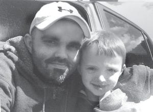 The Letcher County Sheriff 's Office released this photo of Floyd Junior Sexton and his eight-year-old son Nicholas in December. The two were found in Texas this week.