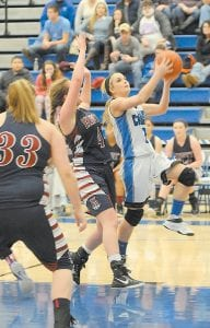 Letcher Central's Sara Baker drives to the basket for a layup in the championship game of the girls' district tournament last week. Baker scored three points in the Lady Cougars' 47-41 win over Knott Central. (Photo by Chris Anderson)