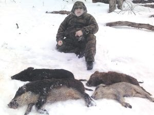 Columnist Steve Brewer is seen with four wild boars he harvested on a recent hunting trip out of state. Kentucky also needs a full wild boar hunting season, Brewer writes this week.