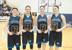 Members of the Lady Cougars named to the 14th Region All-Tourney Team are, from left, tournament MVP Cheyenne Stidham, Courtney Brock, Kelly Adams and Kristina Bentley. (Photo by Chris Anderson)