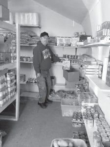 FOOD PANTRY — David Little is shown in God's Food Pantry in Jenkins, which he operates.