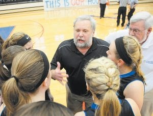 Letcher Central Coach Dickie Adams instructed his players during a timeout in Sunday's tense championship game at Knott Central. (Photo by Chris Anderson)