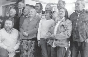 HOWARD FAMILY — Pictured is the family of the late Polly and Leslie Howard, (back row) Kern, Melvin, Leonard, Fred, Lee, Earl Jr., Dexter, (front row) Leroy (son of Bob Howard), Ida, Betty Jean and Mary Lou. The family was in Fort Wayne, Ind., for memorial services for their brother, Bob Howard, and Garland Howard, who died near the same time.