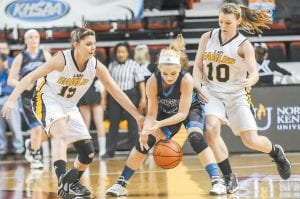 Johnson Central's Lauren Delong (15), Letcher Central's Sara Baker (25), and Johnson Central's Bailey Daniel (10) scrambled for a loose ball during LCC's loss in the KHSAA Sweet 16 girls tournament at E.A. Diddle Arena in Bowling Green. (AP Photo/Daily News, Bac Totrong)