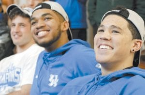 Kentucky basketball players Devin Booker, right, and Karl-Anthony Towns watched the NCAA college basketball tournament selection show at the home of head coach John Calipari on Sunday in Lexington. The Wildcats play Hampton on Thursday. (AP Photo/James Crisp)