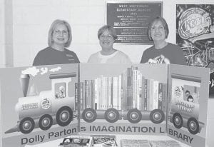 From left, Margaret Hammonds, Evelyn Hensley and Barbara Ison of the Whitesburg Rotary Club participated in Whitesburg Elementary Literacy Night on March 9. The three presented information on the Dolly Parton Imagination Library.