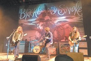 GUITARIST J.D. SIMO AND BAND HERE FRIDAY — Rock guitarist J.D. Simo, pictured here (center) performing with the band Blakberry Smoke in Indianapolis over he weekend, will peform at Summit City in Whitesburg on Friday (March 20). In addition to performing songs with bands such as Blackberry Smoke, Simo has been touring with rock legend Gregg Allman. A video of Simo's peformance on slide guitar with Blackberry Smoke is available on YouTube.