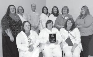 Letcher Manor Nursing & Rehabilitation was recently named the Kentucky River Long Term Care Facility of the Year for 2014. Staff members attended the Kentucky River Area Development District Elder Abuse Council Conference on March 18 in Hazard to accept the award. Pictured are (back row, left to right) Christy Morton, activity director; Carla Bishnoi, administrator; Amanda Stump, LPN; Tammy Young, RN, director of nursing; Scotty Caudill, social service; Gwen Lumpkins, RN; Gretta Fields, administrative support; (front row) Jamie Sturgill, LPN; Heather Smith, LPN; and Amber Lewis, LPN.