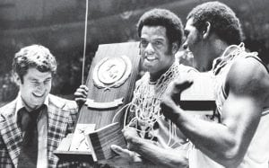 Indiana coach Bobby Knight, left, and team members Scott May, center, and Quinn Buckner right, celebrated with the trophy after winning the NCAA Basketball Championship in Philadelphia on Monday, March 30, 1976. They beat Michigan 86-68. Buckner and his 1975-76 Indiana teammates don't plan on celebrating if their reign as college basketball's last undefeated team continues. Instead, the Hoosiers have waited 39 years to welcome another undefeated national champion if Kentucky goes 40-0. (AP Photo)