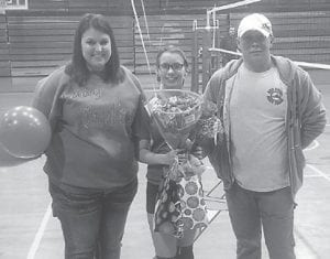 Courtney Mullins with her mother Pam Mullins and her father Barry Mullins.