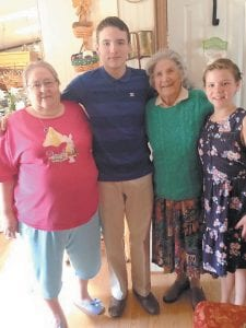 Oma Hatton (second from right) and Maggie Cook (left) are pictured on Easter with their great-grandchildren, Sam and Ellis Mullins, the children of Angie Mullins of Little Dry Fork, at Mrs. Cook's home near Isom.