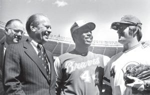 In top photo, Hank Aaron (44) of the Atlanta Braves and Pete Rose (14) of the Cincinnati Reds met U.S. President Gerald Ford, second from left, before start of the season opener at Riverfront Stadium in Cincinnati. Aaron hit his historic 714th home run later in the April 4, 1974 game, trying Babe Ruth's record.