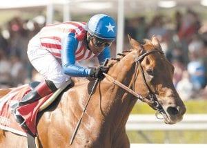 Current Kentucky Derby favorite Dortmund and jockey Martin Garcia won the Grade I $1,000,000 Santa Anita Derby horse race April 4 at Santa Anita Park in Arcadia, Calif. (AP Photo/Benoit Photo)