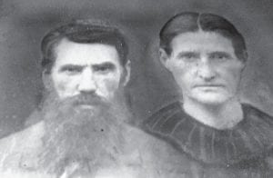 """William Scott Vermillion posed for this portrait with his wife Ella Jane Morgan. Vermillion, was considered one of Letcher County's most prominent citizens at the time of his death in Whitesburg in 1925. The """"Bill Dug Hole,"""" a deep fishing and swimming hole in the North Fork of the Kentucky River, is named for Vermillion."""