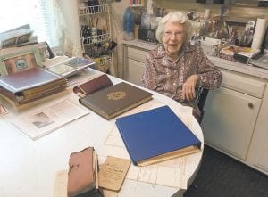 Judith Vermillion displays some of the Vermillion family history she has put together over the years. She has known for years how the 'Bill Dug' got its name.
