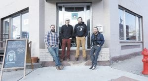 Roundabout Music Company owners (from left) Josh May, Jonathan Hootman, Matthew Carter, and Ben Spangler posed recently in front of the downtown Whitesburg store. In business for less than a year, the store is participating in Record Store Day 2015 on Saturday, April 18. (Photo by Coleman Larkin Schmidt)