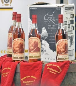 Recovered bottles of 20 year-old Pappy Van Winkle bourbon and Eagle Rare single barrel bourbon were shown during a news conference in Frankfort. Nine people were indicted relating to the theft of more than $100,000 worth of bourbon from the Wild Turkey and Buffalo Trace distilleries. (AP Photo)