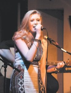 CONCERT OPENER — Tyra Madison Short, a country music singer from Perry County, performed a crowd-pleaser set of music recently when she opened for Nashville artist Logan Brill at Summit City in Whitesburg. Promoter Greg Napier said he hopes Short is able to perform at Summit City again soon. (Photo by Thomas Biggs)