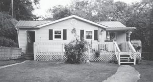 """This is the home of Whitesburg correspondent Oma Hatton and her late husband, Clyde Hatton. Mrs. Hatton says, """"Think of me and us when you see this picture of our home."""""""