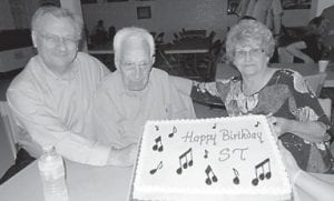 BIRTHDAY — S.T. Wright celebrated his birthday with family and friends at the Hemphill Community Center on April 17. From left to right are Sam Wright, S.T. Wright and Elsie Adams.