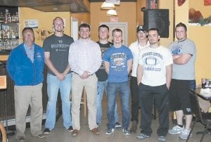 HONORED AT LCC FOOTBALL BANQUET — Senior football players who helped the Letcher County Central High School Cougars to a 9-3 won-loss record and appearance in the state playoffs last fall were honored Monday night at the school's annual football banquet. Shown in this photo are LCC head football coach Mike Holcomb and senior players (from left) Zane Blair, Hunter Hall, Jake Kiser, Eric Brown, Jordan Cook, Marcus Baker and Jordan Boggs.