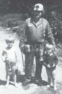 """Benjamin Meade Sr., of Wise, Va., formerly of Whitaker, celebrated his 66th birthday April 14. He is working on 43 years as an underground miner. During his job as a mine foreman for 37 years, he helped men from Kentucky and Virginia get jobs in the mines. This older picture shows him and his two sons, Benjie (right) and Mitchell (left). He said, """"I thank God and Jesus Christ for it all. May God bless all the men and their family that work for me."""" He now works at 9 Mile #3 coal mine."""
