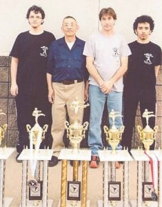 John Ng's Four Seasons Kung Fu & Tai Chi School of Whitesburg, Hazard and Pikeville competed in the Somerslam Martial Arts Tournament April 18 in Somerset. The school competed in forms, weapons and fighting, and had wins in all. Pictured are (left to right) Tyler Creech, Great Grandmaster John Ng, Chief Instructor Frank Sexton and Bobby Briggs.