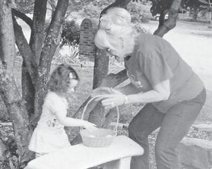 """Beverly """"Goldie"""" Payne of Owensboro is a great neighbor of Robert Hatton. She is pictured with his granddaughter, Elise Hill, having an Easter egg hunt. Whitesburg correspondent Oma Hatton says, """"I'd love to have her for a neighbor!"""""""