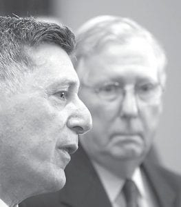 Michael Botticelli, left, director of the White House Office of National Drug Control Policy, answered questions next to Sen. Mitch McConnell, R-Ky., as the two discussed Kentucky's rising heroin problem during a Northern Kentucky Chamber of Commerce luncheon earlier this spring. (AP Photo/The Cincinnati Enquirer)
