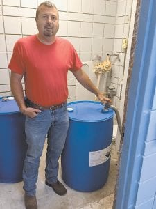 Chris Caudill, Whitesburg's water maintenance director, was photographed in the city water plant's fluoridation room on Tuesday morning. (Eagle photo)