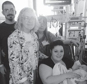 — Jewel McBee traveled to Kosairs Children's Hospital in Louisville to see her great-grandson after his heart surgery. Pictured are four generations of the family, Jewell McBee, daughter Faye Shepherd, grandson Anthony Shepherd and wife Catrina, and greatgrandson Tegan Shepherd.